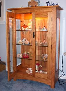 oak curio cabinet with beveled glass